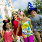A young group of friends enjoying themselves in front of Cinderellas Palace at the Walt Disney World Resort
