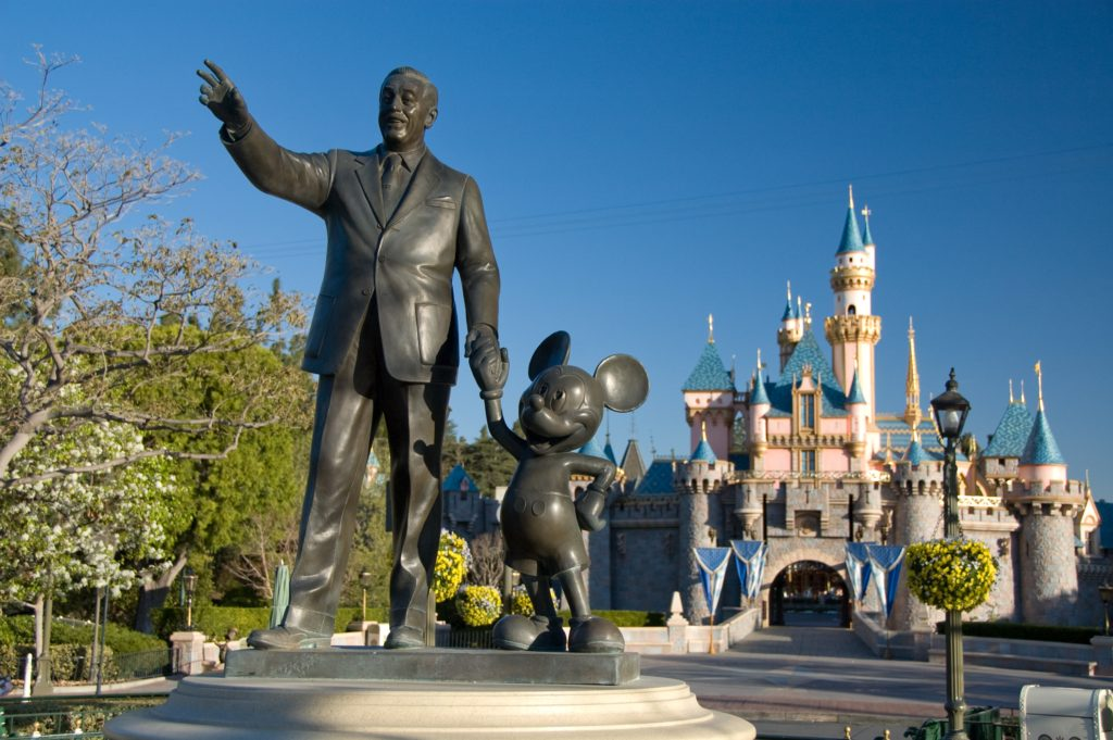 Statue of Walt Disney and Mickey Mouse in front of Sleeping Beauty's Castle at the Disneyland Resort